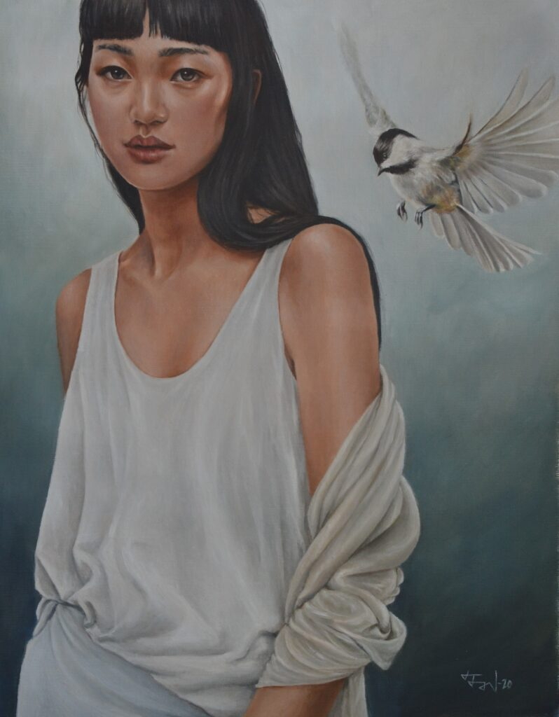a woman and a bird